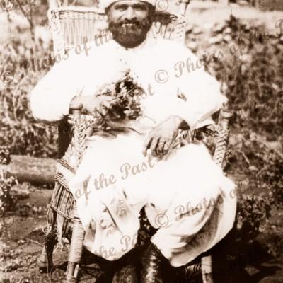 Afghan Cameleer seated