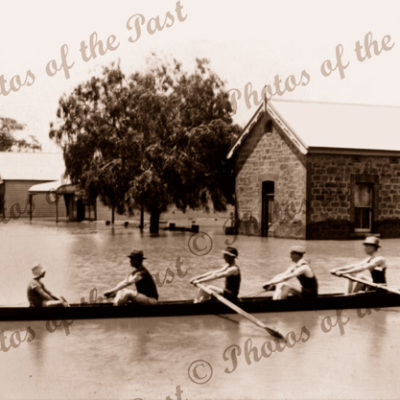 Rowers in flooded street, Mannum SA. South Australia. 1917. Murray River