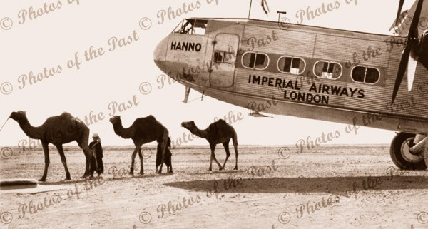 Camels next to Imperial Airways plane,Pakistan,London/Aust air route c1930s