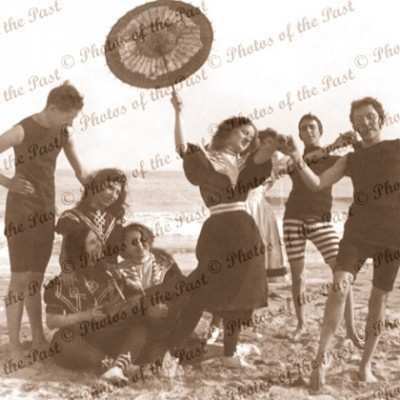 Frolicking at the seaside, beach, bathers c1898