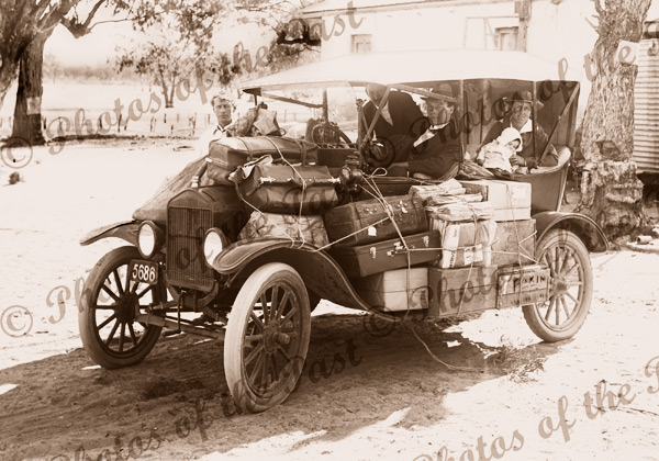 Pendle's Transport Service, Renmark, SA (bags all over old car). South Australia. c1920s. Car