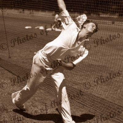 Australian cricketer, Keith Miller bowling in nets. c1940s