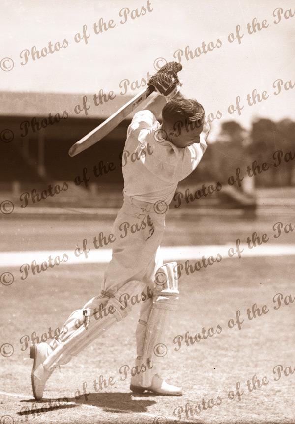 Australian cricketer, Lindsay Hassett with bat. c1938