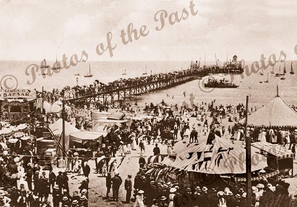 Holiday crowd at Glenelg, SA. c1900. South Australia. Pier, jetty, beach