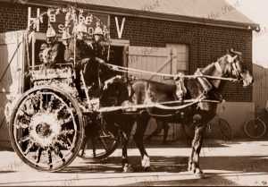 Old horse-drawn fire engine (decorated) with 4 firemen. Hindmarsh, SA. South Australia. 1900s