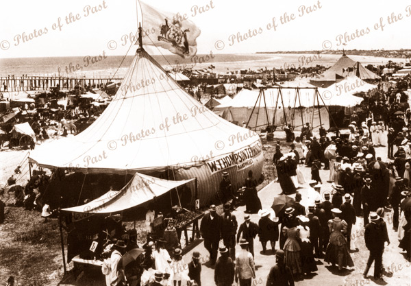 Glenelg foreshore looking north Tents, swings, stalls lots of people. 1896. South Australia