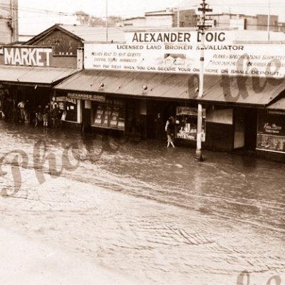 Flooded Unley Road shops, SA. c1950s. South Australia