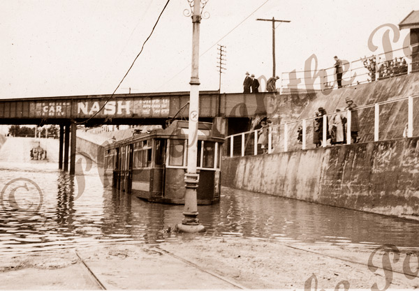 Tram in flooded subway at goodwood, SA. South Australia. c1920s