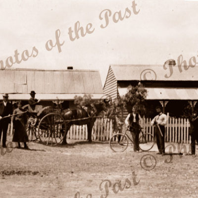 Gun group outsides houses at Goolwa SA. South Australia. c1910. Horse and carriages