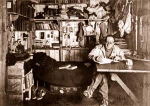 Scott writing his diary in Winter Quarters. British Antarctic Expidition. BAE c1911