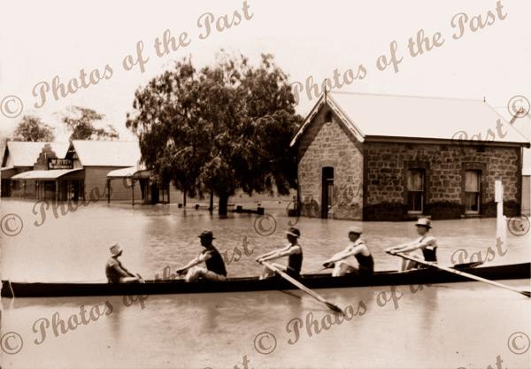 Rowers in flooded street, Mannum SA. South Australia. 1917. Murray River