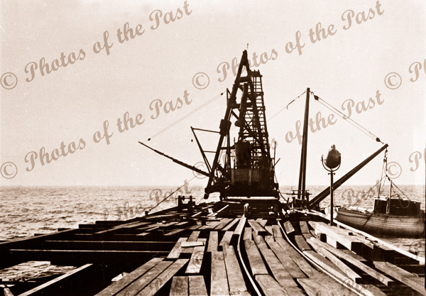 Construction of Rapid Bay Jetty, SA. Showing pile driver. C1940s. South Australia. Pier