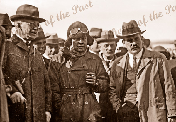 South Australian Governor (left), Harry Butler, Chief Justice Geo. Murray & crowd. After epic flight across Gulf St Vincent. The first flight across water in Southern hemisphere. August 1919