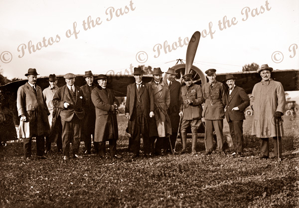 Harry Kauper & Harry Butler (in uniforms) with members of the press at Northfield SA 31 July 1919. Airplane. South Australia.