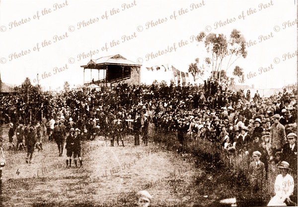 Crowd watching aviator Harry Butler at Unley Oval, SA. 'Unley Aviation Day. 23 August (poor) 1919. Grandstand. South Australia.