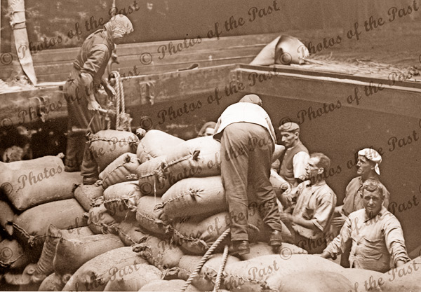 Loading wheat into a ship, Port Melbourne, Victoria. c1910s