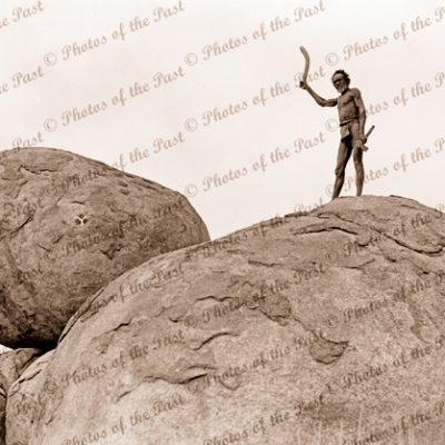 Aborigine hunter with boomerang, Devils Marbles, near Tennant Creek NT. Northern Territory 1936