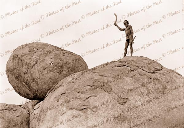 Aborigine hunter with boomerang, Devils Marbles, near Tennant Creek NT. Northern Territory 1936