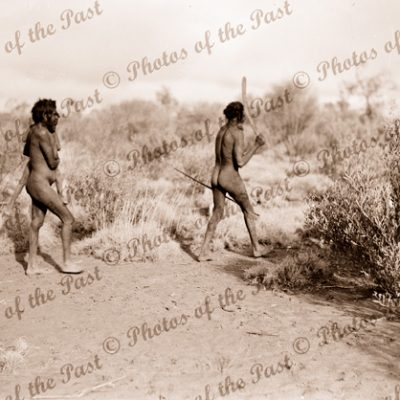 Aborigine family. Woman with boy, man with spear & boomerang. c1936