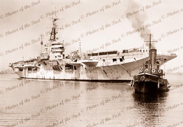 HMAS VENGEANCE Arriving at Melbourne, Victoria. Tug EAGLE. 1953