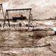 Rough seas at Glenelg, SA. South Australia. Beach. 1932. swings