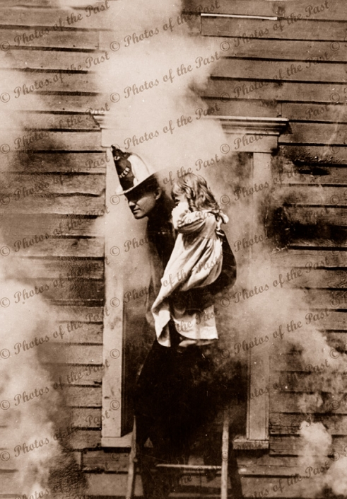 The Rescue (Fireman rescues child) from burning building. c1900. girl