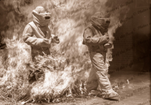 Fire drill. Walking though fire in protective suits. 1940