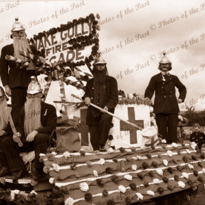 'Snake Gully Fire Brigade' Red Cross float in a parade c1930s