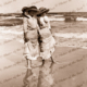 Down at the seaside. Two ladies wading in the shallows. c1920s. Beach