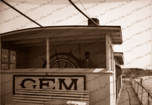 Captain Payne at wheel of PS GEM. Paddle steamers, river boats