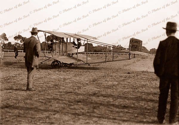 Caudron Pusher? Bi-plane about to take off. AW JONES No2 on tail. Possibly Cheltenham Racecourse, SA. C1913