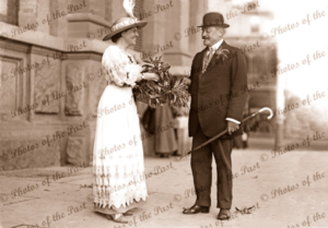 Wattle Day. Adelaide, SA. Posh gentleman buys a spray of wattle. H or V orientation. 1918. South Australia.