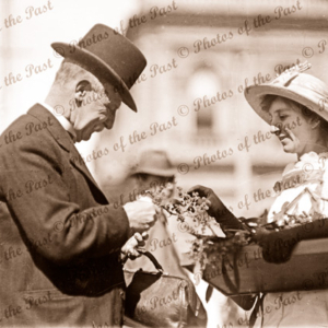 Wattle Day. Adelaide, SA. Posh gentleman buys a spray of wattle. 1918. South Australia.