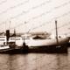 Tug WATO towing hulk SS WOOKATA to Shell Berth. STRATUS beyond. Shipping. South Australia. 1949. Port Adeliade
