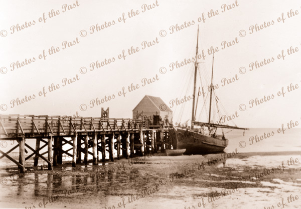 Whitemark jetty on Flinders Island, SA. Ketch stranded at low tide. South Australia