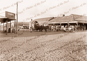 Alf Richardson's Hotel on Corner main St with coach leaving. JJ Barrettt's General Store on left (near) corner. White Cliffs, NSW. New South Wales. 1908.