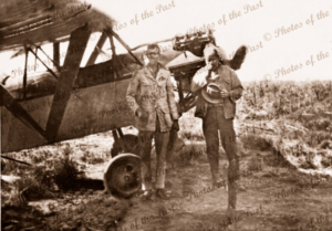 G-AUKA Westland Widgeon, Flt-Lieut C Eaton & L Moray at site of RS (Bobby) Hitchcock's grave under the plane's wing. Tanami Desert, NT. Northern Territory. 1929