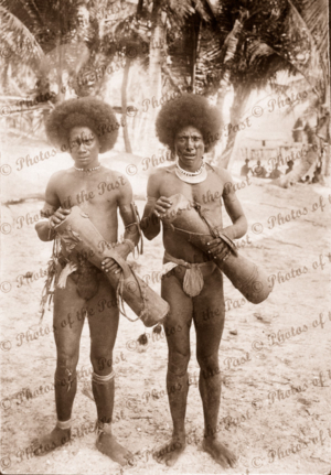 Two Papuans with kundu drums. Papua New Guinea