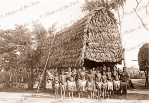 New Guinea house with lots of women. Papua New Guinea. Possibly women only house?