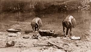 Women preparing yams at river's edge on Guadalcanar, Solomon Islands, c1916