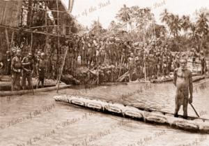 Native village. Houses on stilts. Dugout canoes. Papua New Guinea, c1920s