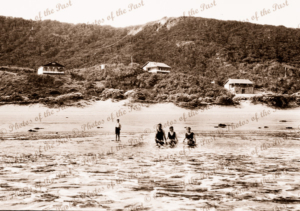 Bathers in sea at Eastern View. Great Ocean Road, Vic. Houses on hillside in background. c1920s-1930s
