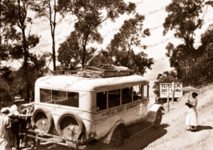 Birtle's Tourist Services bus (De Dion Bouton) on the Melbourne - Geelong & Lorne route stopped at Iluka Rest Home, Big Hill, Great Ocean Road. c1920s-1930s
